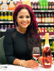 Christina Milian flaunts her red locks at a recent meet and greet.